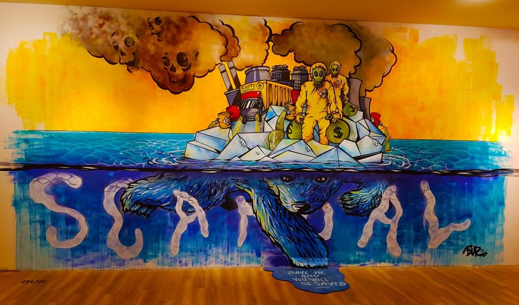Le réchauffement climatique vu par le street artiste lyonnais BUR pour l'exposition street art à la Confluence, Lyon