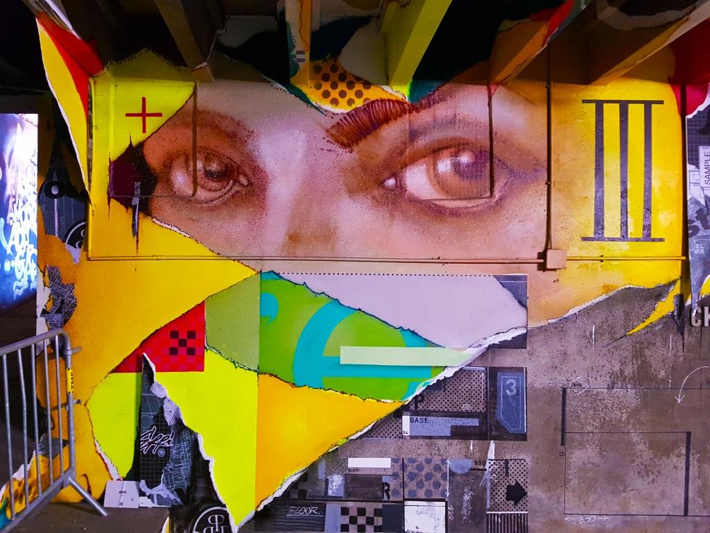 Le style d'Erpi est reconnaissable avec ses lettres entremêlées à des fragments de visages ultra-réalistes, posés au cœur de textures différentes pour sa participation au festival street art Peinture Fraîche de Lyon